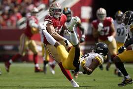 San Francisco 49ers fullback Kyle Juszczyk, left, breaks a tackle attempt by Pittsburgh Steelers free safety Minkah Fitzpatrick during the first half of an NFL football game in Santa Clara, Calif., Sunday, Sept. 22, 2019. (AP Photo/Tony Avelar)