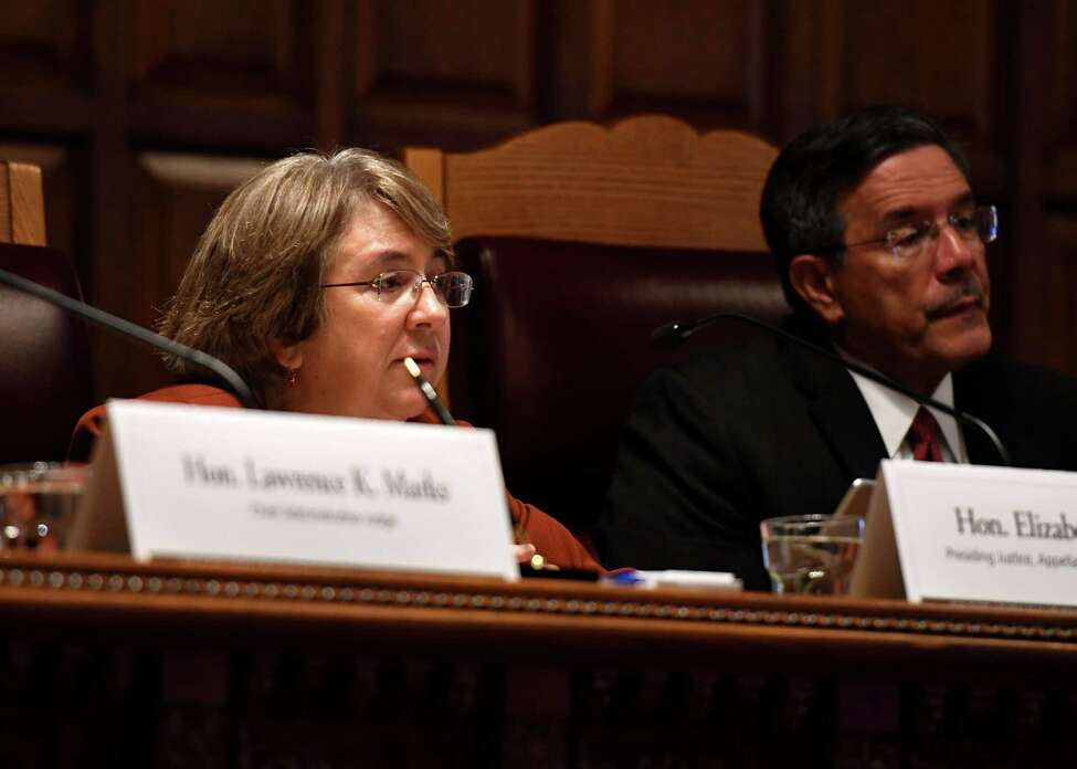 Appellate Justices Elizabeth Garry, left, and Rolando Acosta, right, question presenters during a public hearing to evaluate the civil legal services needs in New York on Monday, Sept. 23, 2019, at the Court of Appeals in Albany, N.Y. (Will Waldron/Times Union)