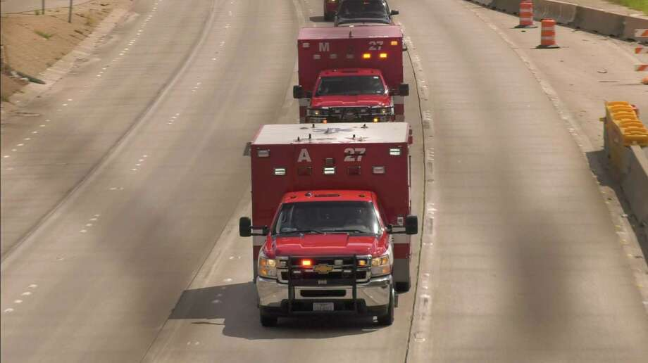 A procession carrying the body of Houston firefighter Kenneth Stavinoha, who was 36 when he collapsed at Houston Fire Department Station 27 on Saturday, proceeds along Texas Highway 288 near South MacGregor Way Monday, Sept. 23, 2019, in Houston. Photo: Jay R. Jordan, Staff / ©Houston Chronicle