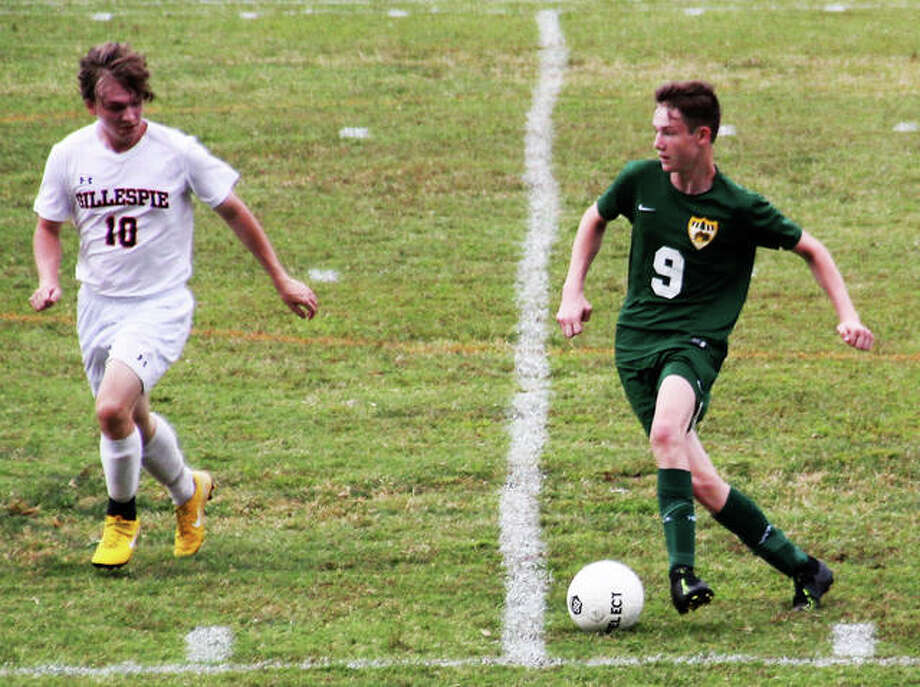 MELHS junior Luke Neath, right, moves the ball up the field on Saturday.