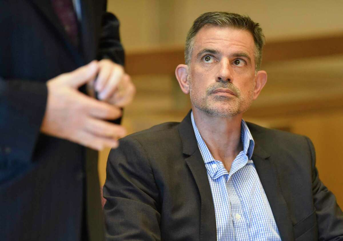 Fotis Dulos appears at the Connecticut Superior Court in Stamford, Conn. Monday, Sept. 23, 2019. Dulos, who was twice charged with evidence tampering in relation to the disappearance of his ex-wife Jennifer Farber Dulos, was back in court Monday to address issues with his GPS monitoring device. The device must be charged at the same time every day and has dipped below a 25 percent battery charge at least four times in the past month.