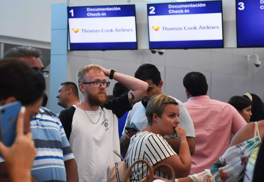 Passengers queue at the closed Thomas Cook check-in desk at the International Airport in Cancun, Mexico. Photo: Elizabeth Ruiz / AFP / Getty Images