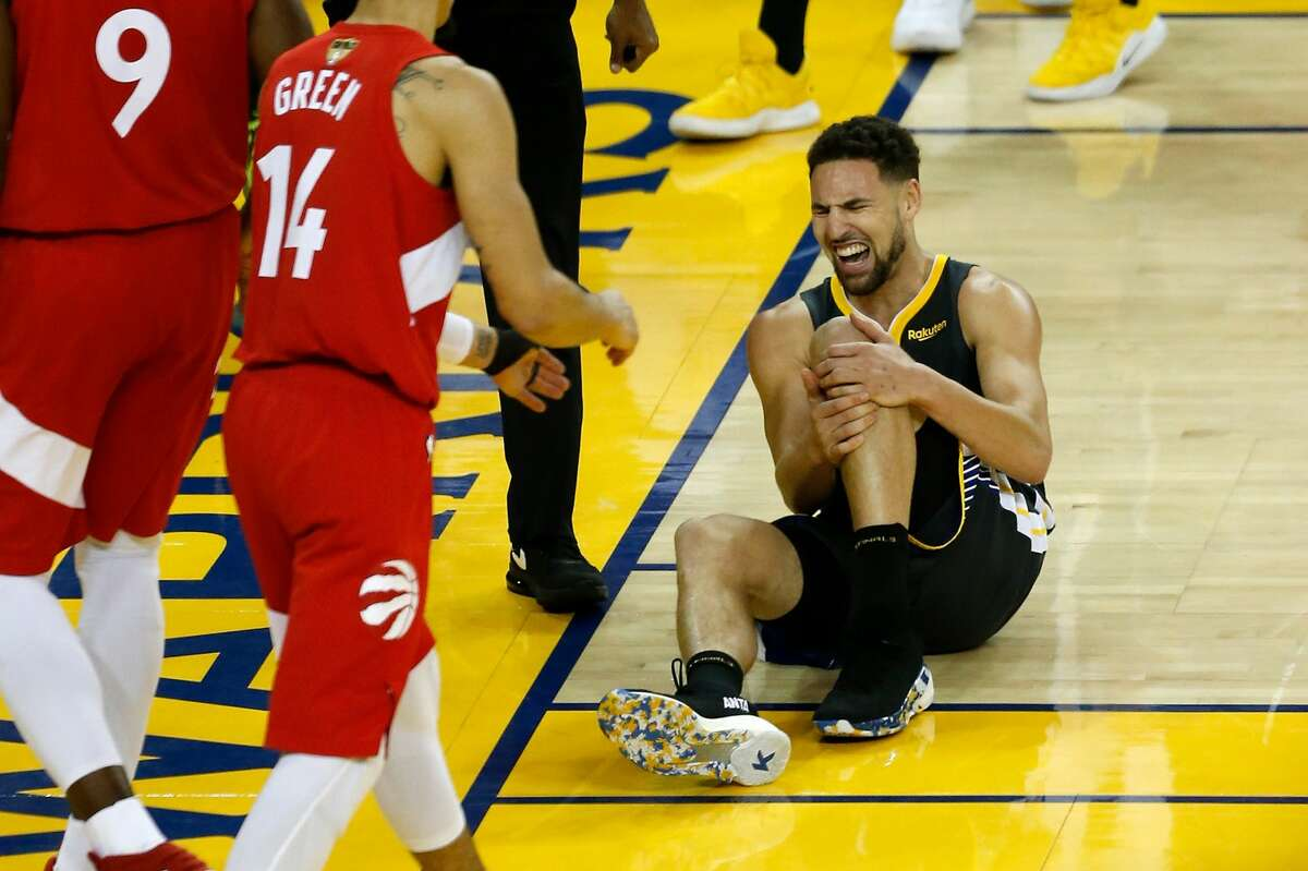 Klay Thompson of the Golden State Warriors reacts after tearing his ACL against the Toronto Raptors in the second half during Game Six of the 2019 NBA Finals at Oracle Arena on June 13, 2019, in Oakland.