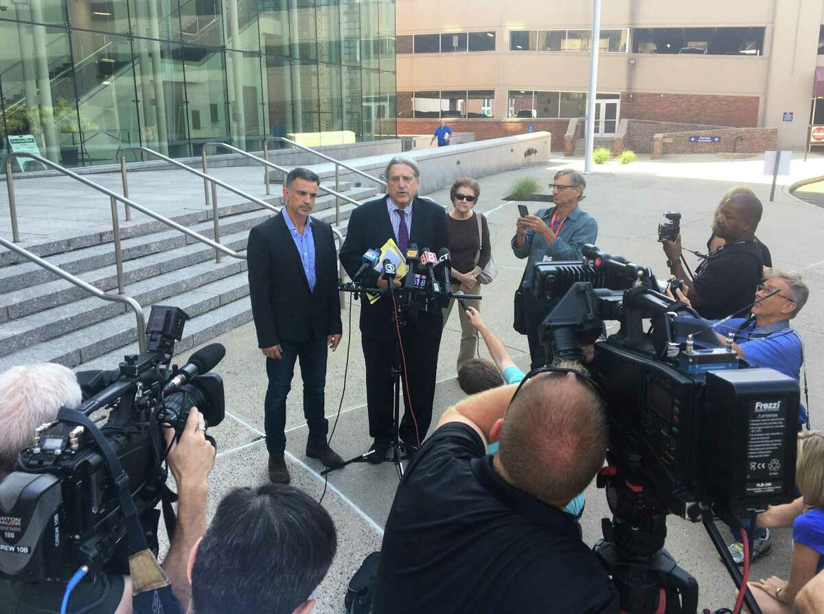 Fotis Dulos, left, and his attorney Norm Pattis address the media after appearing at the Connecticut Superior Court in Stamford, Conn. Monday, Sept. 23, 2019. Dulos, who was twice charged with evidence tampering in relation to the disappearance of his ex-wife Jennifer Farber Dulos, was back in court Monday to address issues with his GPS monitoring device. The device must be charged at the same time every day and has dipped below a 25 percent battery charge at least four times in the past month.