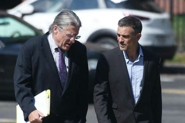 Fotis Dulos, right, appears with his attorney Norm Pattis at the Connecticut Superior Court in Stamford, Conn. Monday, Sept. 23, 2019.