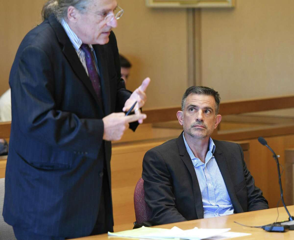Fotis Dulos, right, appears with his attorney Norm Pattis at the state Superior Court in Stamford on Sept. 23.