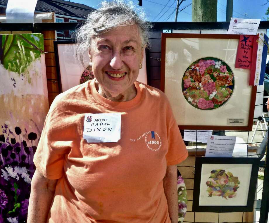 "Two ASOG member artists in the 2019 Art Society of Old Greenwich Sidewalk Art Show, which took place on September 14 and 15, received special awards given by the Dowling Group, a financial services company in Greenwich. Carol Nipomnich Dixon, pictured, won the Dowling Group Award for her embroidered collage, ""Garden,"" and Lucie Anderes won the J.M. Dowling CPA Award for her oil painting, ""A Bridge at Tod's Point."" Photo: ASOG / Contributed Photo"