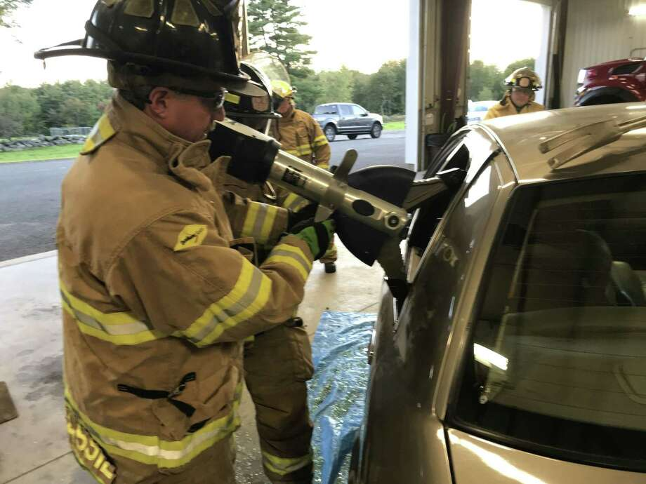 Members of the Winchester Volunteer Fire Department had their first training session with a Hurst Rescue Tool, which was purchased with a $12,600 donation from the Auxiliary for Community Health. Photo: Peter Marchand / Contributed Photo /