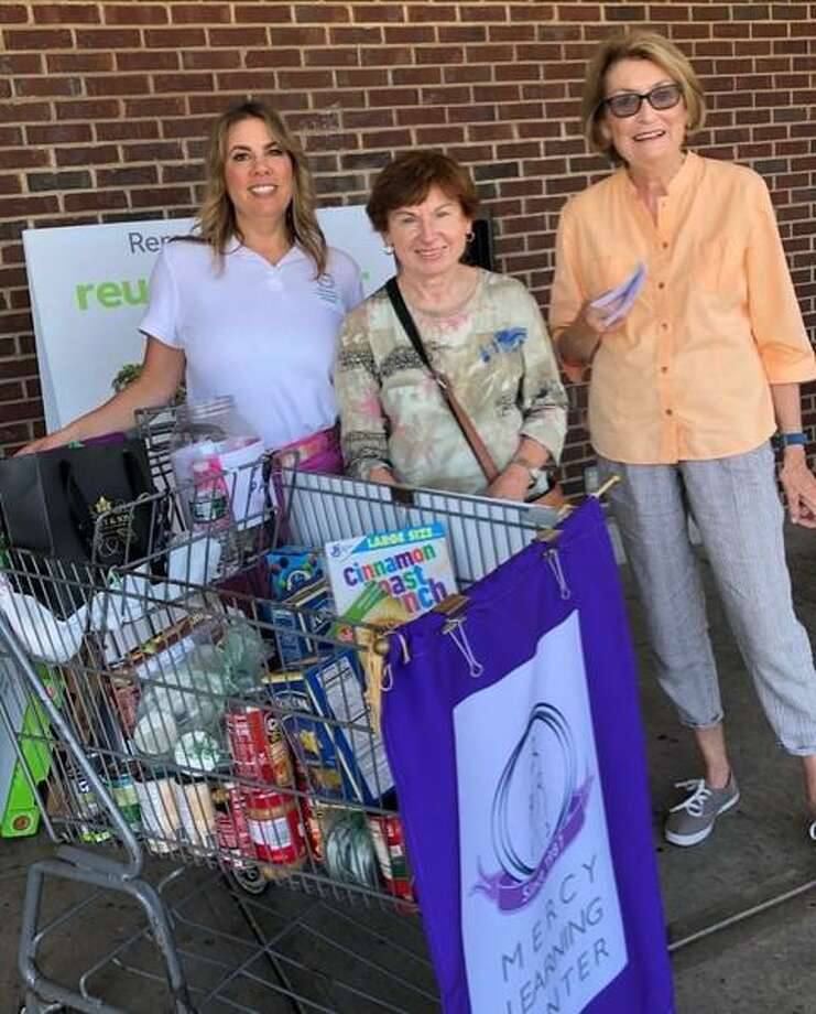 On Saturday, Sept. 21, Trumbull Community Women conducted a food drive at the Stop and Shop on Main Street in Bridgeport. Proceeds and food collected went to the Bridgeport Rescue Mission, which is one of the many service organizations being supported by the women's group this year. The trio is Julie Howes, Anna Lozynlak and Sheila Hayes. Photo: Contributed Photos /
