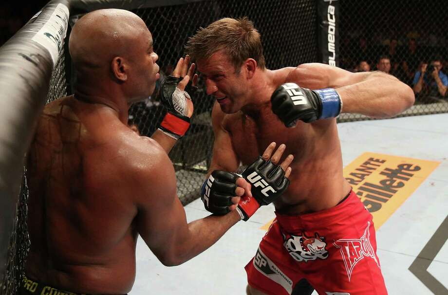 Stephan Bonnar, right, fighting Anderson Silva in 2012, holds black belts in Brazilian jiujitsu and Tae Kwon Do. Bonnar, a fan of pro wrestling, recently transitioned into sports entertainment. Photo: Josh Hedges /Zuffa LLC Via Getty Images / 2012 Josh Hedges/Zuffa LLC