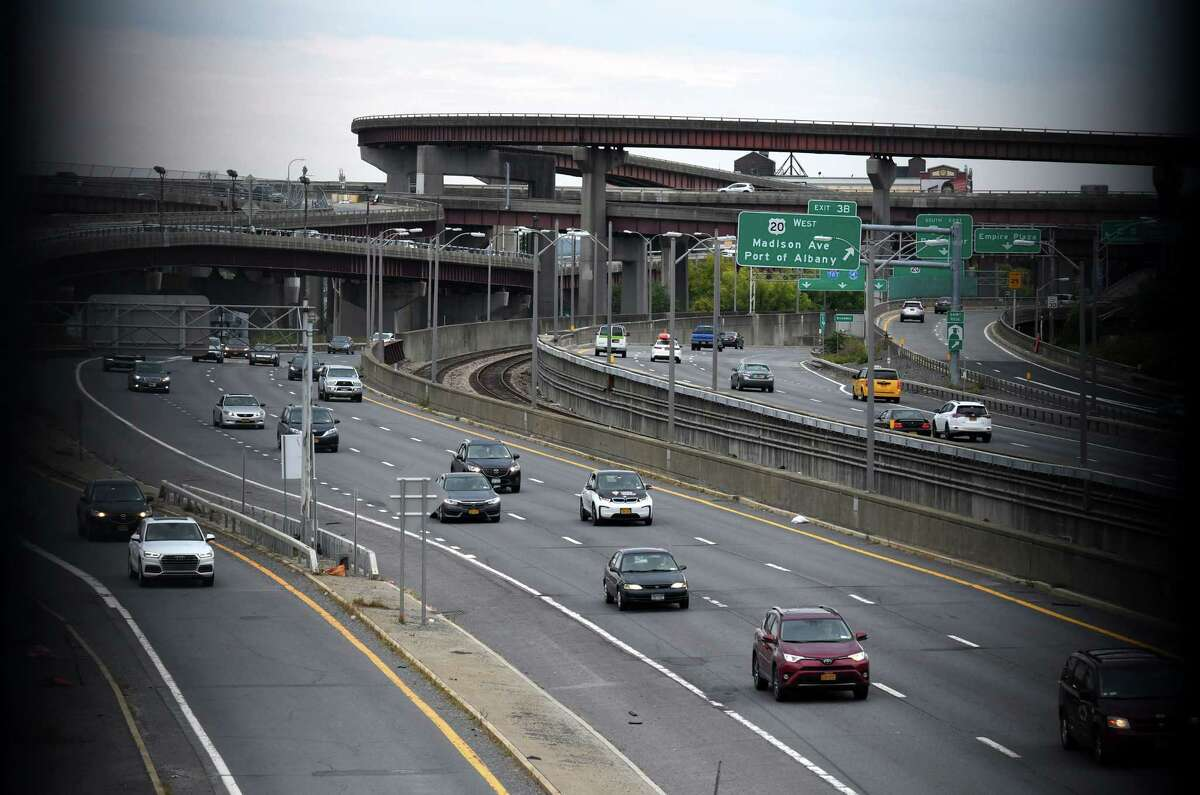 Traffic moves along I-787 through downtown Albany. Could the money needed to tear the highway down finally be available? (Will Waldron/Times Union)