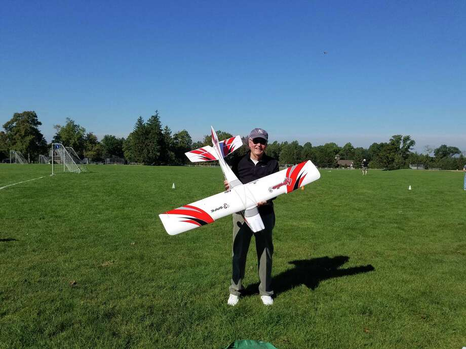 Gene Dunkin shows off his newly constructed radio-controlled airplane before it is flown for the first time. Photo: Grace Duffield / Hearst Media Connecticut