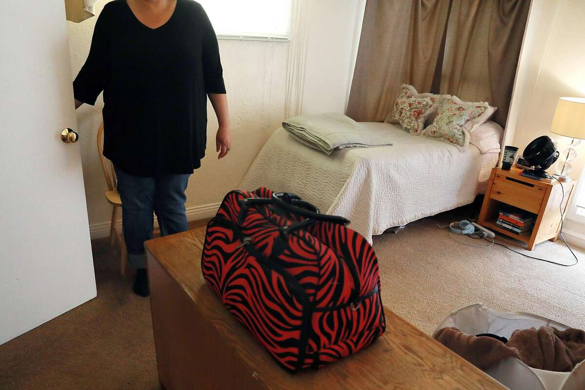 Progress Foundation co-op resident Melanie Brandt stands in her room at a Progress Foundation co-op in the Oceanview district on Monday, May 20, 2018 in San Francisco, Calif.