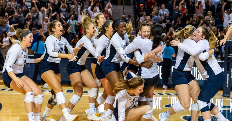 The Rice volleyball team after upsetting No. 3 Texas on Wednesday, Sept. 18, 2019. Photo: Maria Lysaker/Rice Athletics