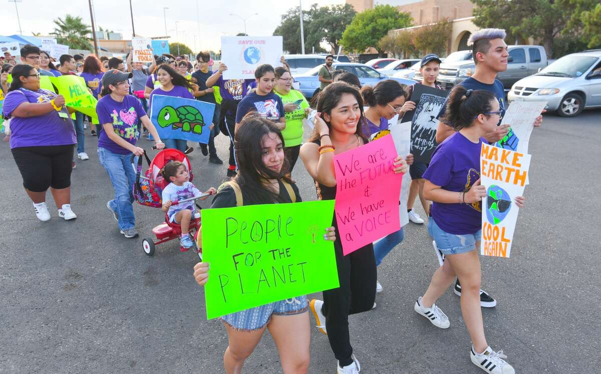 Citizens concerned with climate change gathered at the Jesus Martinez Performing Arts Complex, Saturday, Sep. 21, 2019, as they walk down San Bernardo Avenue as part of the Global Climate Strike.