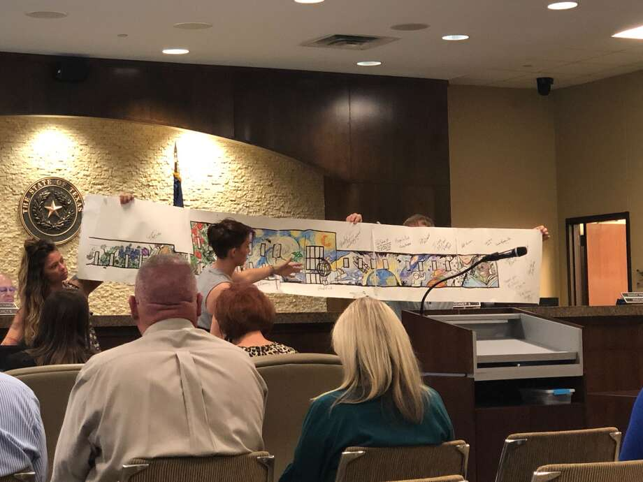 """The designs from Abilene artist Calina Johnson featured a velveteen rabbit, a """"Starry Night""""-inspired piece, galaxy motif and children reading books. Johnson showed sketches of the designs during Monday's Commissioners' Court meeting.  Photo: Caitlin Randle"""
