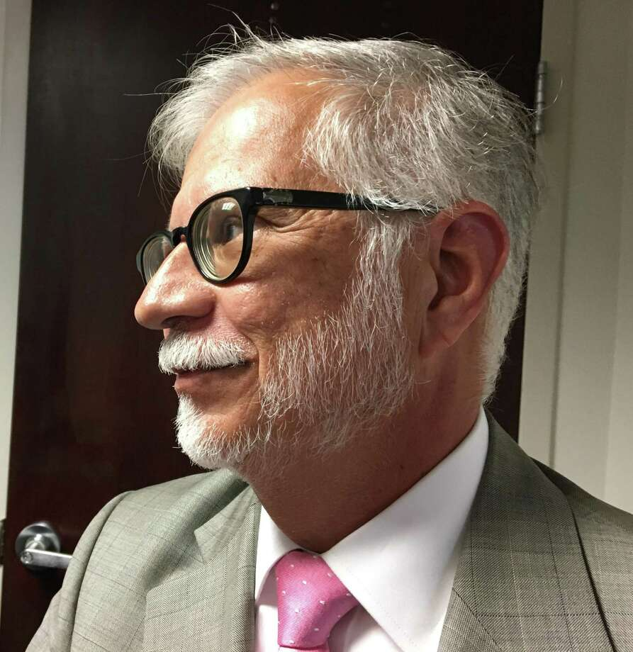 Marilyn Moore's campaign attorney Maximino Medina delivered a complaint on the September 10 mayoral primary to the State Elections Enforcement Commission on Monday. Photo: Ken Dixon