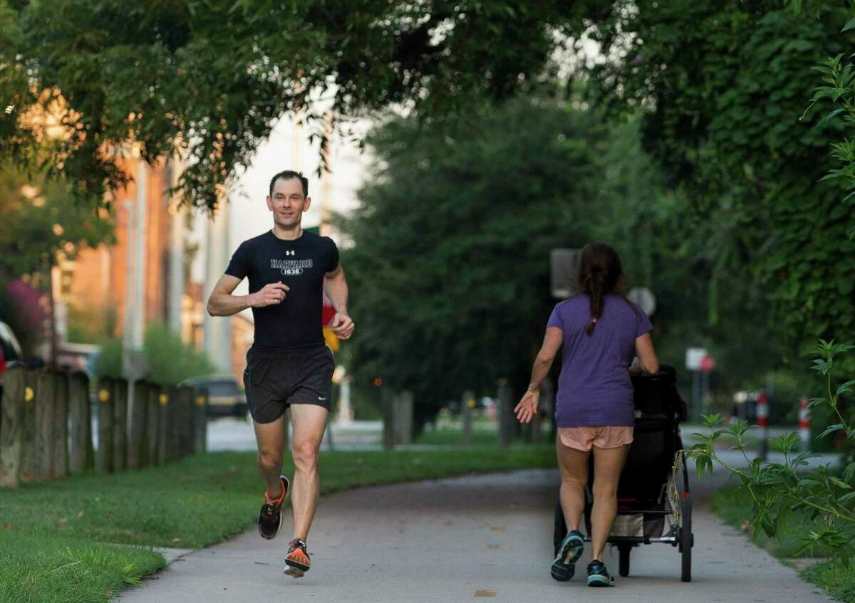 Dr. Theodore Shybut, 41, runs on a bike and pedestrian lane on East Seventh Street during his morning run in the Woodland Heights on Wednesday, Sept. 4, 2019, in Houston. Shybut was on the crew team in college and tries to maintain healthy as an orthopedic surgeon.