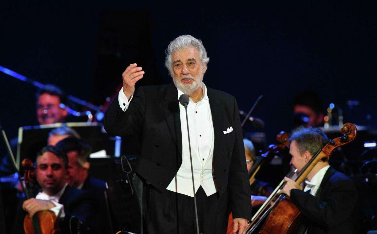 Spanish tenor Placido Domingo gestures as he performs during his concert in the newly inaugurated sports and culture centre 'St Gellert Forum' in Szeged, southern Hungary, on August 28, 2019. (Photo by Attila SEREN / AFP)ATTILA SEREN/AFP/Getty Images