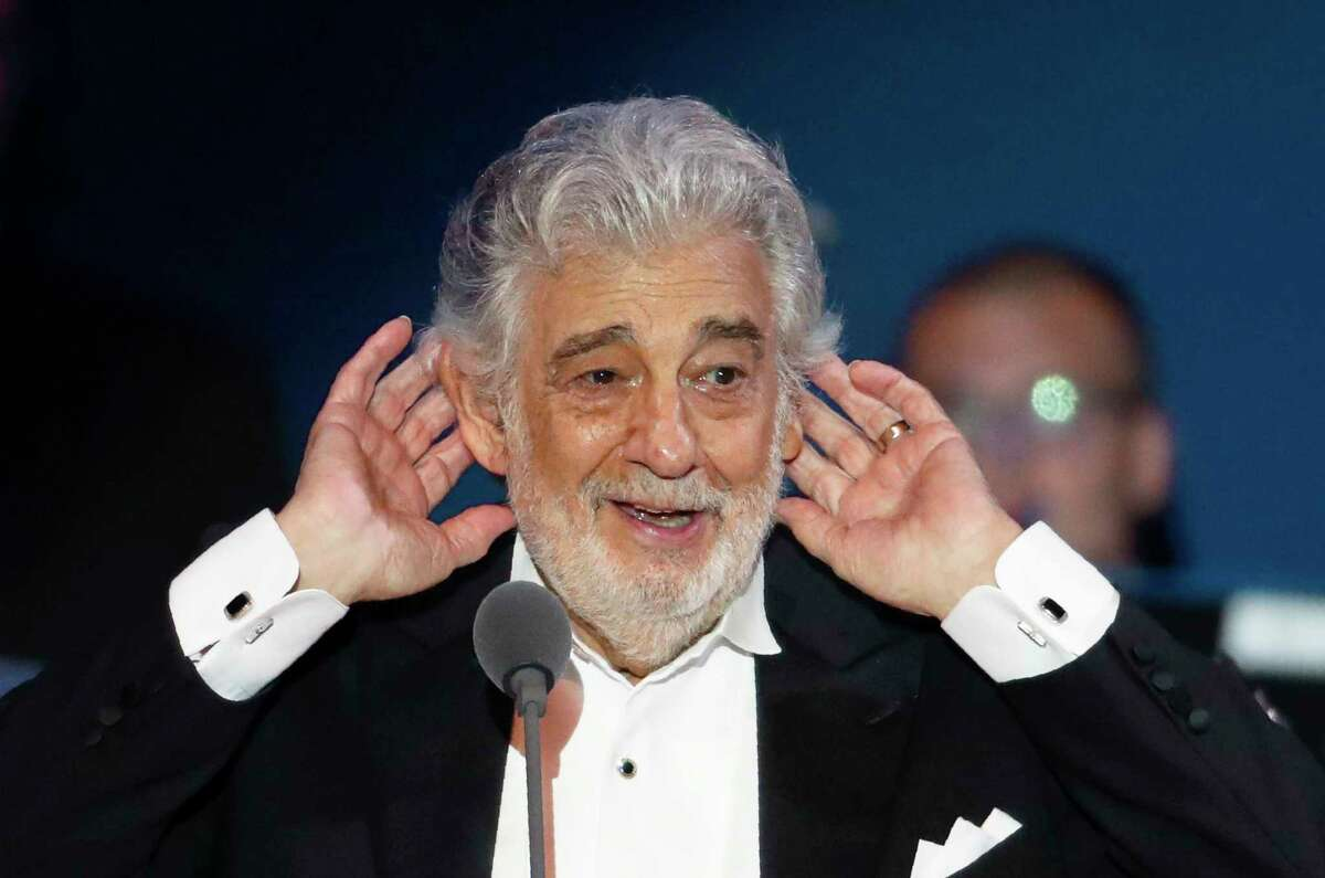 """FILE - In this Aug. 28, 2019 file photo, opera star Placido Domingo listens to applause at the end of a concert in Szeged, Hungary, Wednesday, Aug. 28, 2019. When Domingo appeared in Europe last month after being accused of sexual harassment by multiple women, he was greeted with rapturous ovations. This week, the spotlight moves to the U.S., where the opera legend is due to help kick off the new season at New York's Metropolitan Opera and where he faces two investigations into his behavior. The singer has called the allegations """"in many ways, simply incorrect"""" without supplying any specifics. (AP Photo/Laszlo Balogh, File)"""
