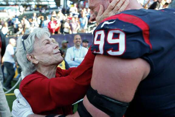 Texans co-founder Janice McNair, left, embraces defensive end J.J. Watt after Sunday's victory over the Chargers in Carson, Calif.