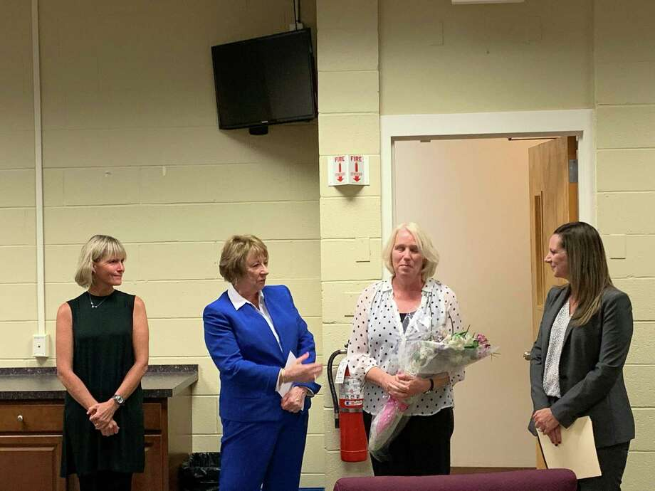 Scotland Elementary School paraeducator Alyce Rae, clutching flowers, was recognized as 2020 Paraeducator of the Year for Ridgefield Public Schools at the Board of Education's September 23 meeting. From left to rigth: Board chair Margaret Stamatis, Interim Superintendent JeanAnn Paddyfote, Rae, and Scotland Principal Jill Katkocin. Photo: /