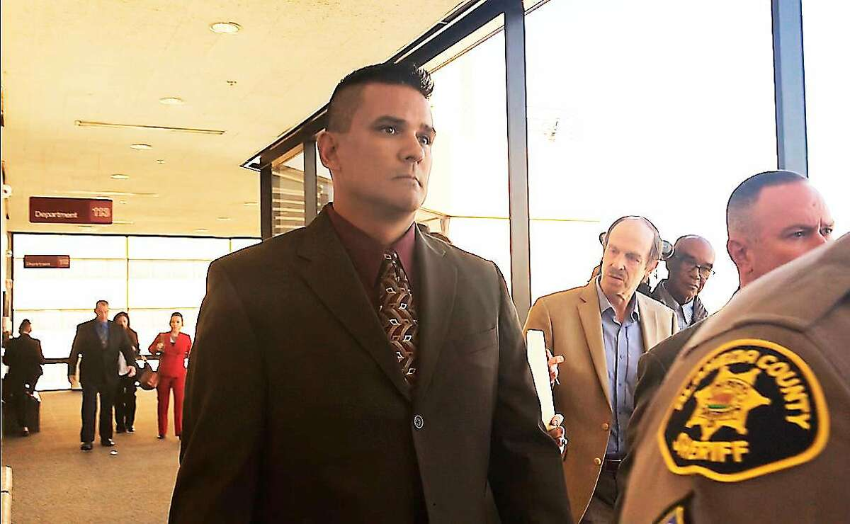 Alameda County Sheriff's Office Sgt. James Russell leaves an Oakland hearing Oct. 17, 2018. Russell is charged with four counts of felony eavesdropping for allegedly recording privileged conversations with juvenile suspects and their attorney.