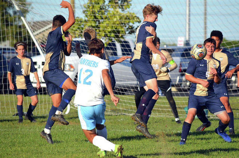 Father McGivney defenders react to a free kick during the second half of Monday's home game against Pinckneyville. The ball deflected over the crossbar. Photo: Scott Marion/The Intelligencer