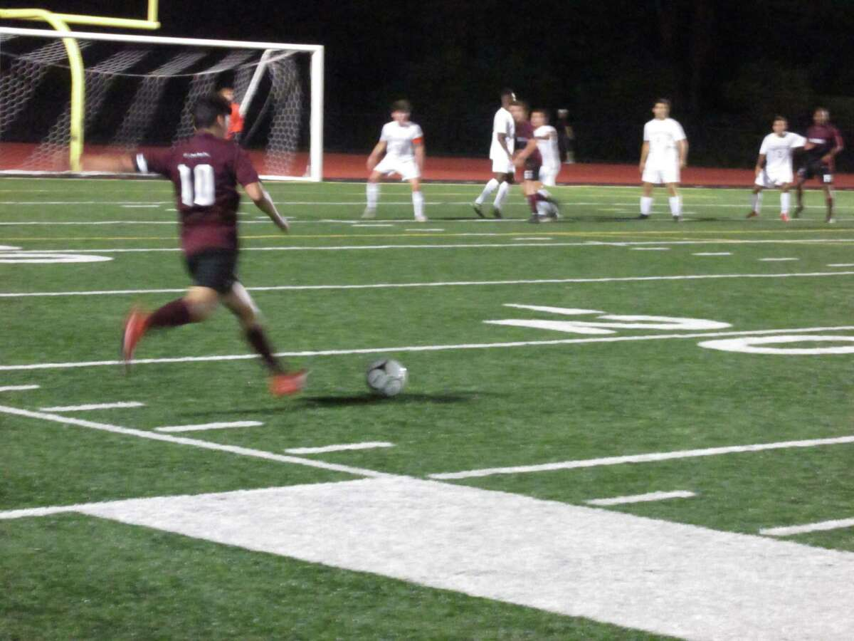 Torrington star Xavier Rodas sends a free kick into a sea of Greyhounds in Naugatuck's narrow win over the Red Raiders Monday night at the Robert H. Frost Sports Complex.