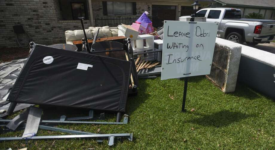 "A sign that reads ""Leave Debris Waiting on Insurance"" sits in the front yard of Erika Szudzik house in Nederland Monday. Photo taken on Monday, 09/23/19. Ryan Welch/The Enterprise Photo: Ryan Welch/The Enterprise"
