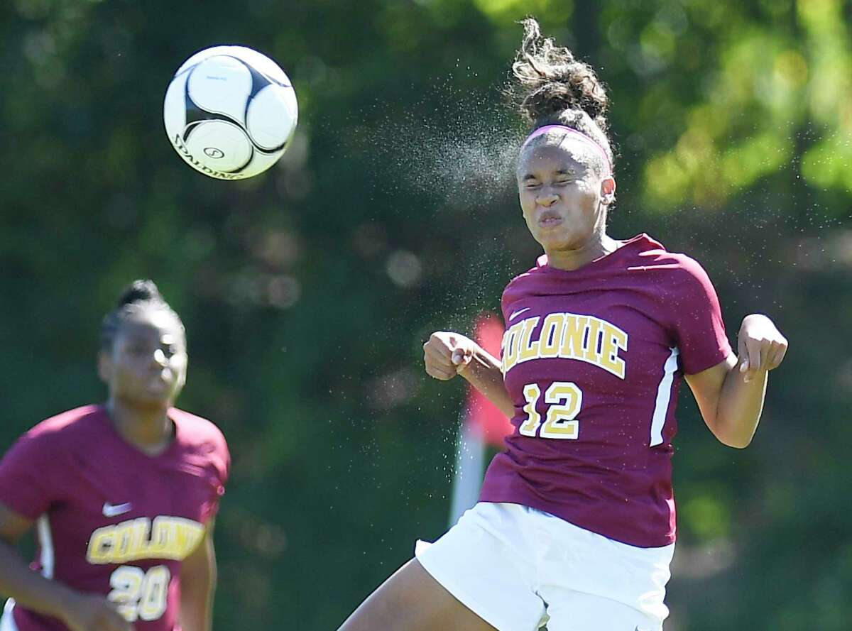 Colonie's Ianah Mackey (12) heads the ball during a Section II girls' soccer game against Guilderland in Colonie, N.Y., Saturday, Sept. 21, 2019. (Hans Pennink / Special to the Times Union)
