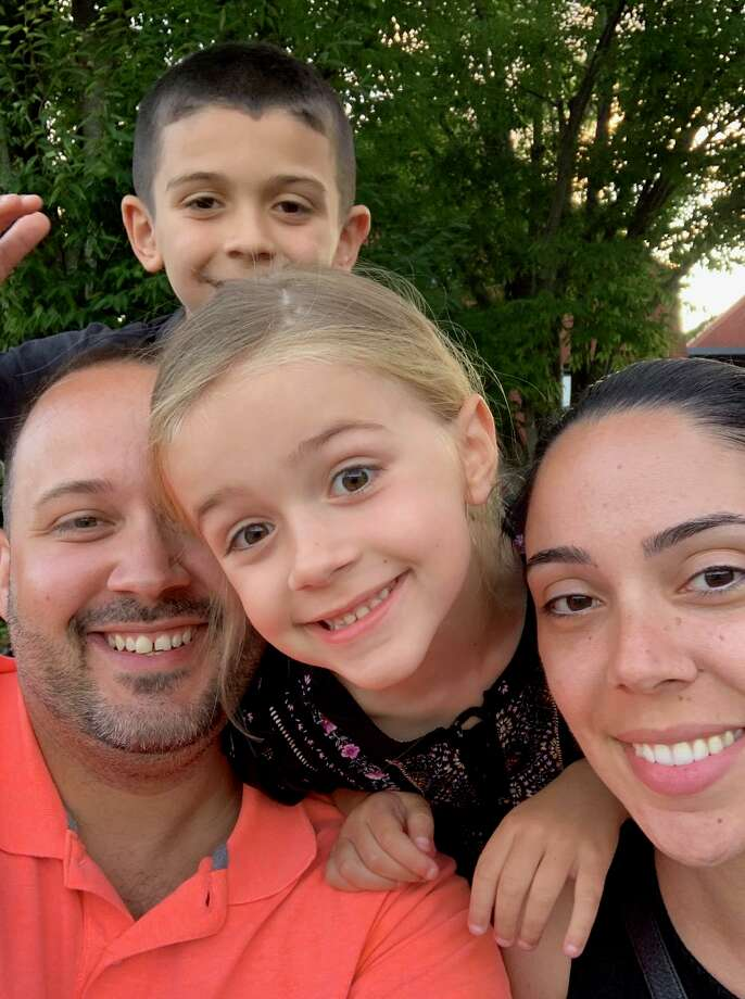 Daniel Vieira and his wife, Katrina Lage, with daughter, Liv, and son, Armando, have created LivFree to help children suffering from cancer and their families. Photo: Contributed Photo / Connecticut Post