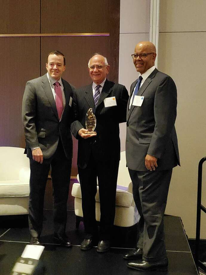 Dr. Ramesh Wadhwani, CEO of Saisystems International, center, receiving the 2019 Supplier of the Year Category III award. Also pictured are GNEMSDC President & CEO, Peter F. Hurst, Jr., right, and GNEMSDC Board Chair Jim Linehan of Blue Cross Blue Shield of Massachusetts. Photo: Contributed Photo / Connecticut Post