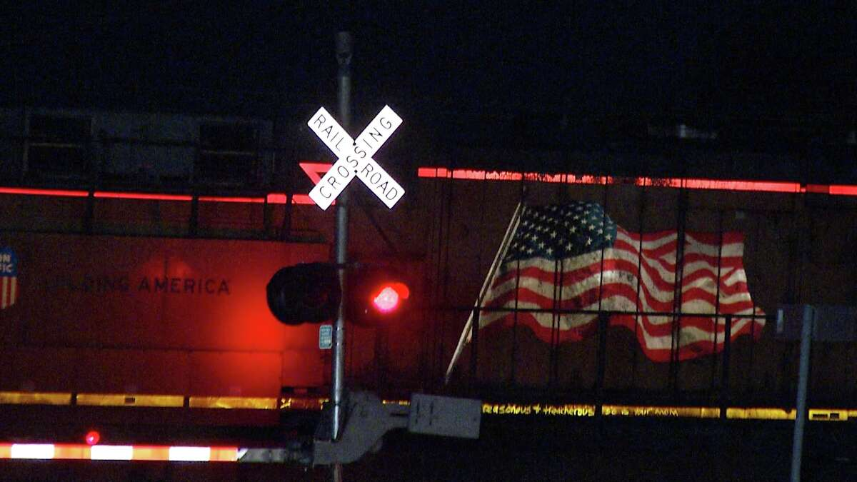 A woman was hospitalized Monday after getting clipped by a train.