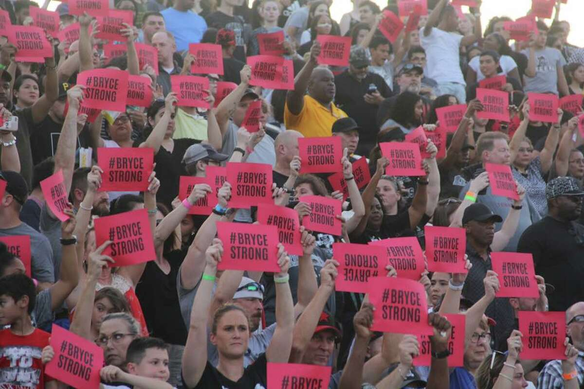 The Converse community shows their support with #BryceStrong placards for 16-year-old Bryce Wisdom during a Sept. 20 football game against Cibolo Steele. Bryce Wisdom, who is a member of the Judson Rockets, is battling kidney cancer.