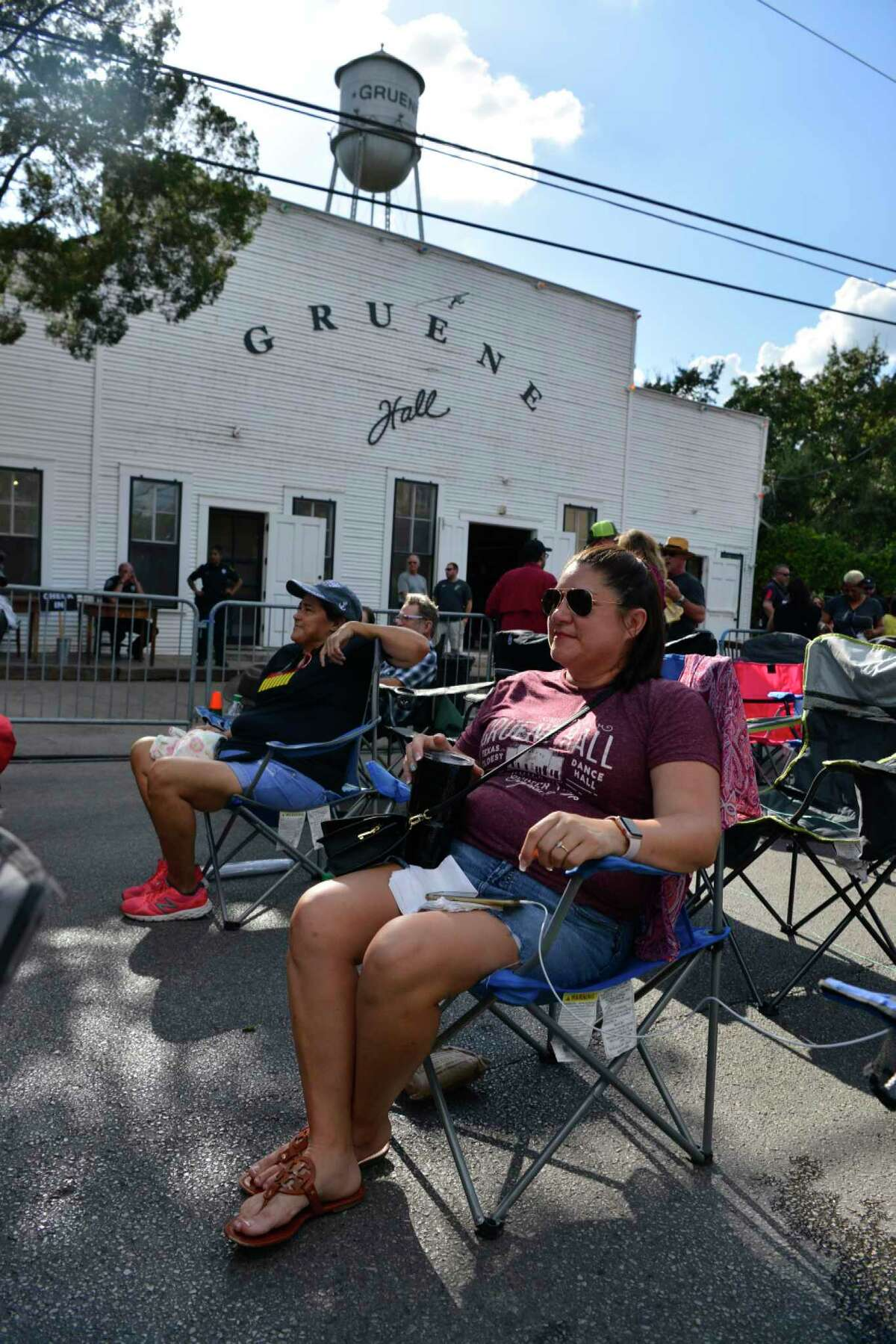Samantha Rivera waits outside Gruene Hall for an evening performance by Garth Brooks as part of his