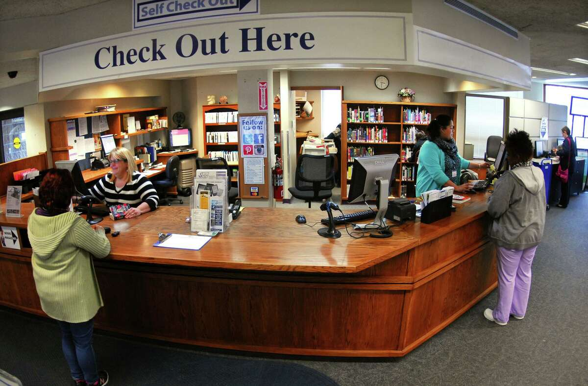 Patrons utilize the Stratford Library in Stratford, Conn., on Tuesday Apr. 7, 2015. Gov. Malloy's budget proposes eliminating the popular Connecticard program, which allows people from the state to use any library in the state. The cuts would also hurt the inter-library loan program, which transports books among libraries around the state as well.