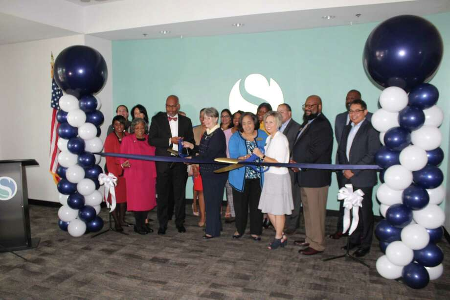 Spring ISD Board Members cut the ribbon celebrating the opening of Spring ISD's TeachUp Spring Learning Center, a new building where Spring ISD teachers will receive professional development training. Photo: Paul Wedding