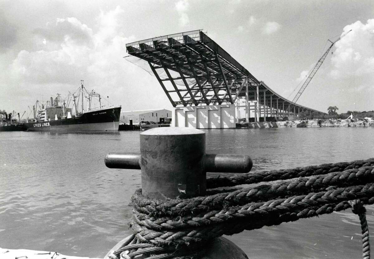 September 1971: Jutting out high above the Houston Ship Channel is the completed initial phase of the first bridge that will span the waterway. When it is completed in 1973, the bridge will carry 10 lanes of traffic over the channel on Interstate 10's east loop. Houston Post photographer Fred Bunch took this shot from the opposite bank where work will begin shortly on the second phase of the $9.5 million project.