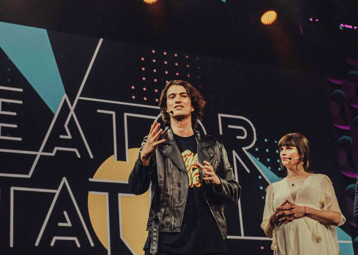 """FILE -- Adam Neumann, WeWork's chief executive, alongside his sister, Adi, onstage at the """"2018 Creator Awards at Madison Square Garden in New York, Jan. 17, 2018. Some board members and large investors in WeWork are privately discussing whether and how to replace the Neumann and trimming his power to salvage the company?•s fortunes, people involved in the talks said. (Cole Wilson/The New York Times)"""