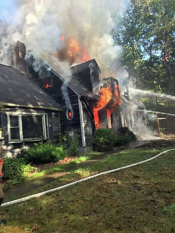 A fire heavily damaged a house at 35 Twin Oak Farm Road in Wallingford on Tuesday, Sept. 24, 2019. Photo: James Sandy Everson Photo