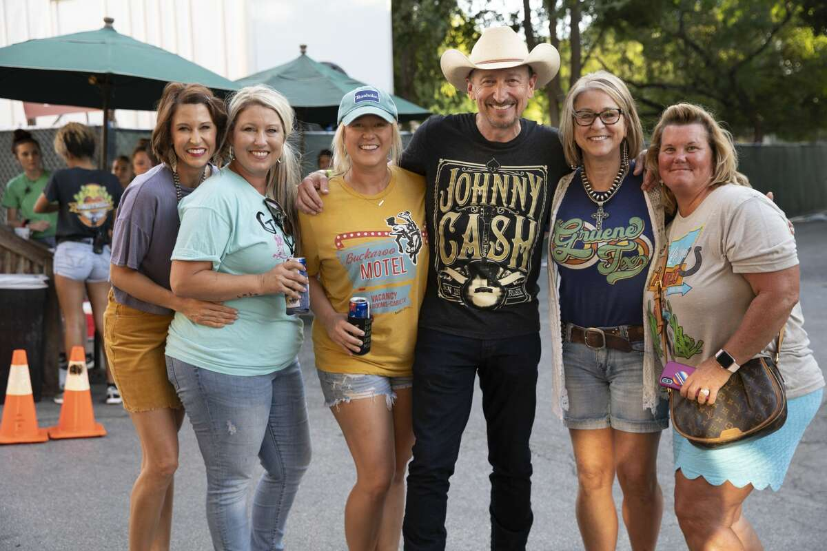 Thousands of Garth Brooks fans headed to Gruene for a mini-festival while the country music star played inside Gruene Hall on Monday, Sept. 23, 2019. Food, drinks and TV screens were available for those who didn't have a ticket to catch the singer inside the venue.