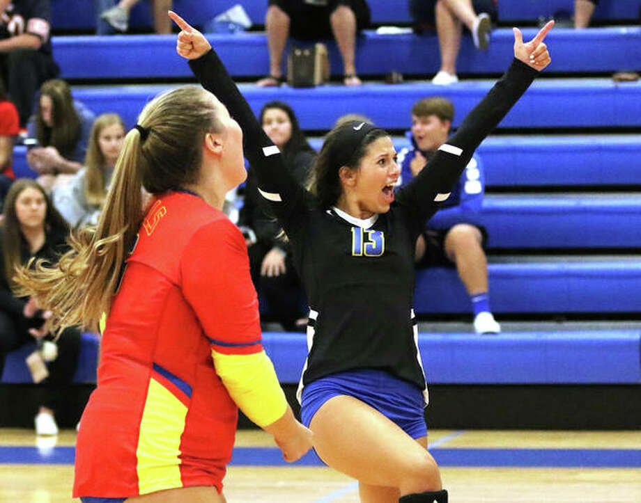 Roxana libero Makenzie Keller (right), coming off a school-record 28 digs in a three-set loss to Pana, made 20 digs Monday night in a three-set win over Marquette in Roxana. Keller is shown celebrating a point with teammate Jacey Trask in a Roxana Tourney match in August. Photo: Greg Shashack / The Telegraph