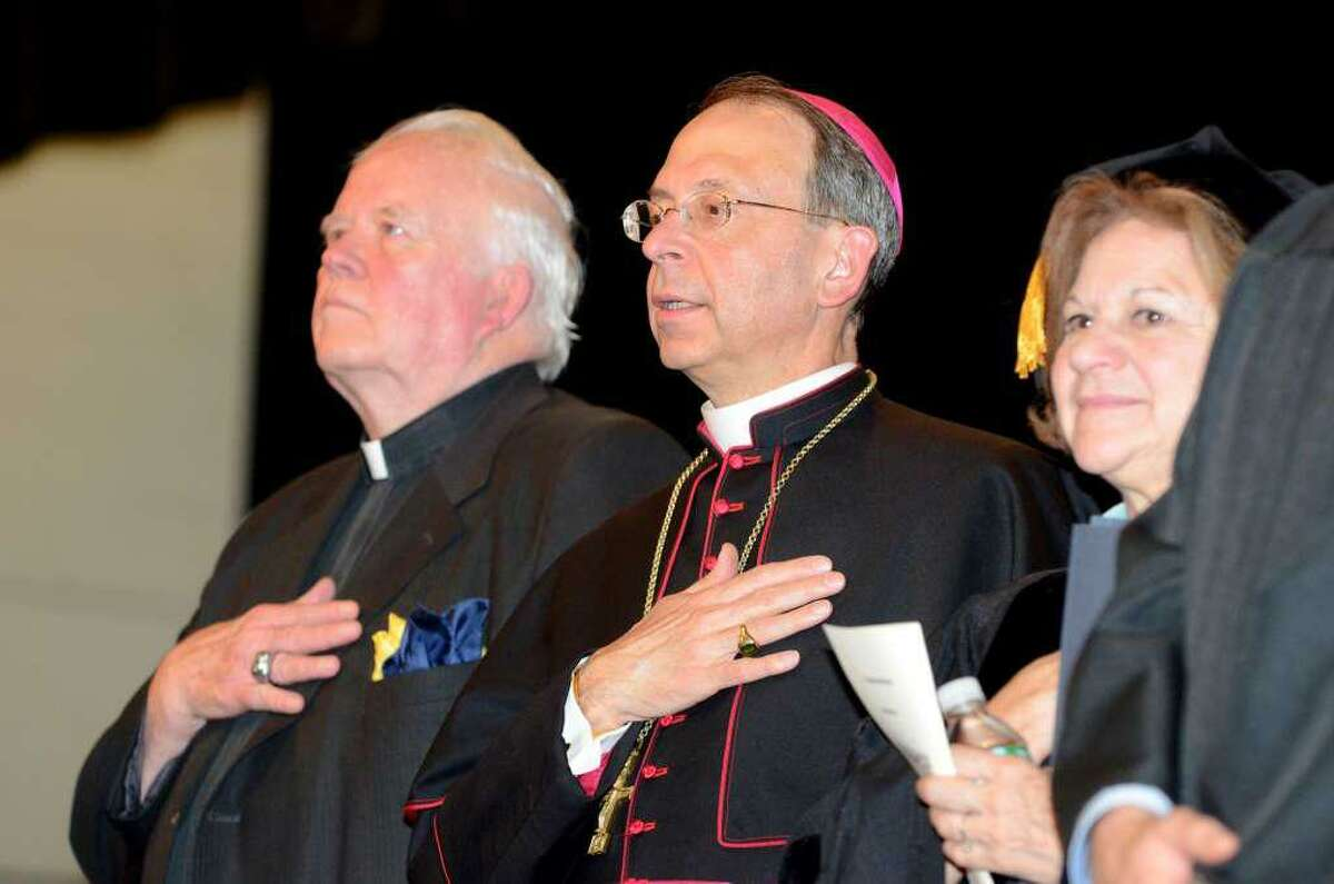 Reverend Bill Sangiovanni, President of Notre Dame Catholic High School, Bishop William Lori and Superintendent Margaret Dames stand during the National Anthem during the 2011 Notre Dame Catholic High School Commencement at Notre Dame in Fairfield on Saturday, June 4, 2011.