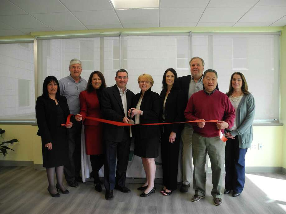 Wilton Chamber of Commerce members attended the ribbon-cutting ceremony for the Connecticut Infusion Center in May. From left, Bankwell Vice President Vittoria Maccaro; Chamber of Commerce member Brian Perry; Debby Rowland, executive director of the infusion center; infusion center co-owner Dr. Barry Stein, First Selectwoman Lynne Vanderslice; Lisa Fusco, infusion center territory sales manager, and Pat Russo, Tom Sato and Susan Goldman of the Wilton Chamber of Commerce. Photo: Jeannette Ross / Hearst Connecticut Media / Wilton Bulletin