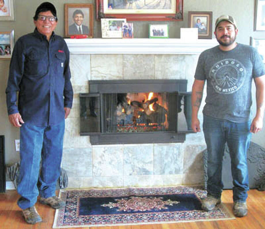 Bill (left) and Josh Rodriguez are the experts at chimney cleaning and  fireplace repair. Call 682-5157  for that or to have them install cheery  gas logs in your home. Photo: Paul Wiseman