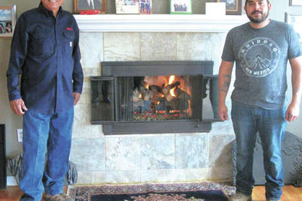 Bill (left) and Josh Rodriguez are the experts at chimney cleaning and fireplace repair. Call 682-5157 for that or to have them install cheery gas logs in your home.