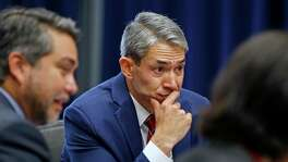 Mayor Ron Nirenberg listens along with Councilman Robert Treviño during a 2018 committee meeting. Nirenberg has pushed for the construction of protected bike lanes on a stretch of Broadway, while Treviño has insisted that section of the project will not lend itself to bike lanes.