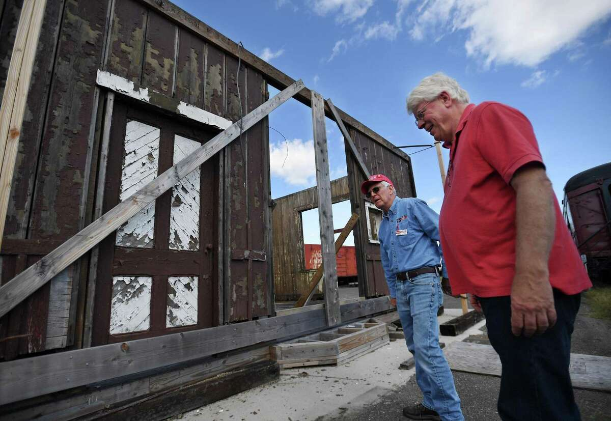 Danbury Railway Museum volunteers Steve Gould, left, of Shelton, and Stan Madyda, of New Fairfield, with the Mill Plain Station being reassembled and restored in the museum's rail yard in Danbury, Conn. on Wednesday, September 18, 2019. The rescued station was built in 1881.