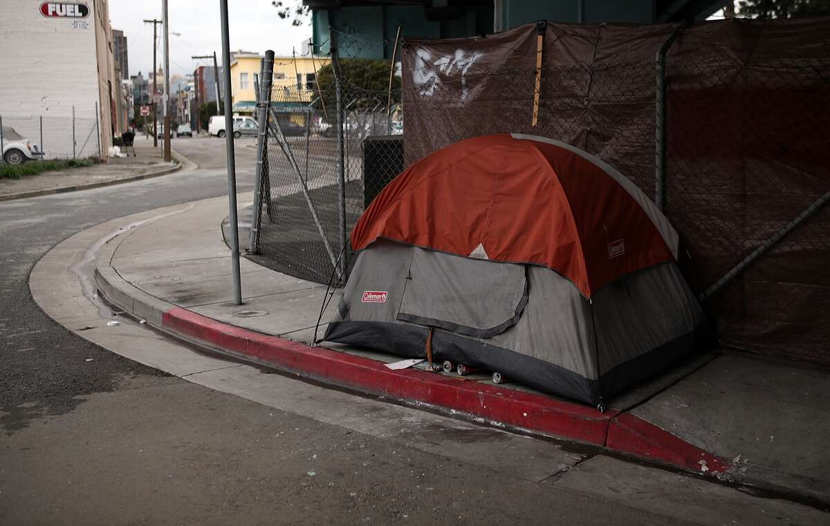A tent used by a homeless person blocks a San Francisco sidewalk in this 2010 file photo.